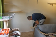 Drilling the holes to attach them to the wall mounts. Using wood drills is helpful